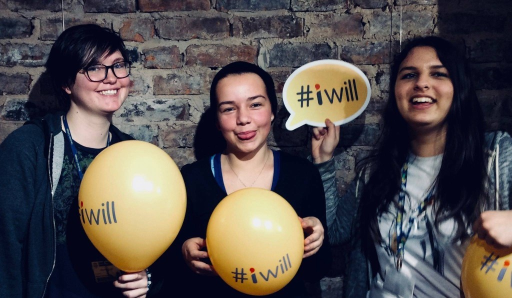Young people holding #iwill balloons