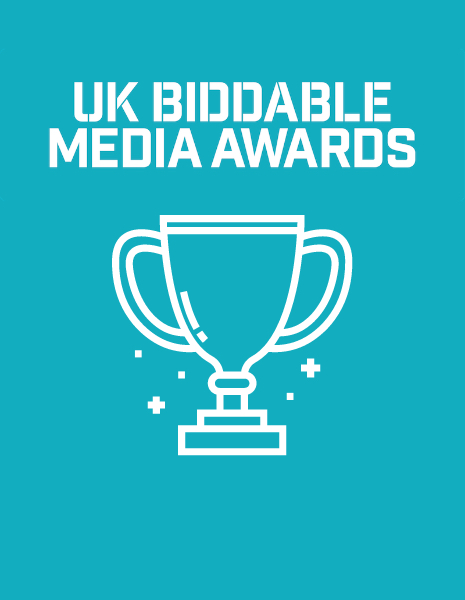 """Text reading """"UK Biddable Media Awards"""" over an illustratred trophy"""