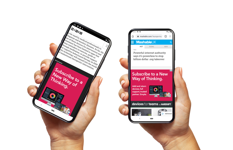 Two hands holding phones showing Hardsoft being featured in digital publications.