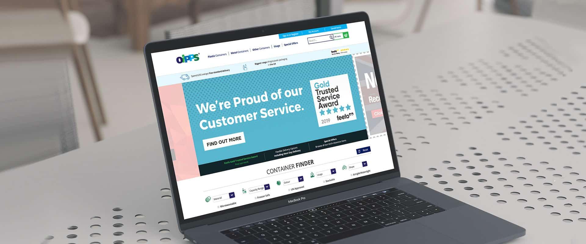 Oipps website shown on a laptop.